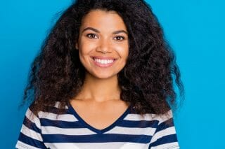 Woman in striped blue sweater smiling